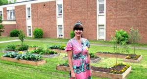 Anna Aquino poses in front of the vegetable garden at Chimborazo