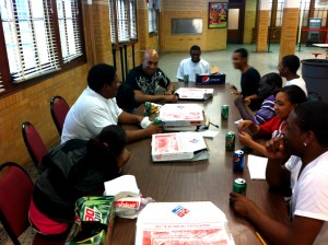 Students enjoy a lighthearted moment with Pastor Jones at one of their 9-week Awards Pizza Parties